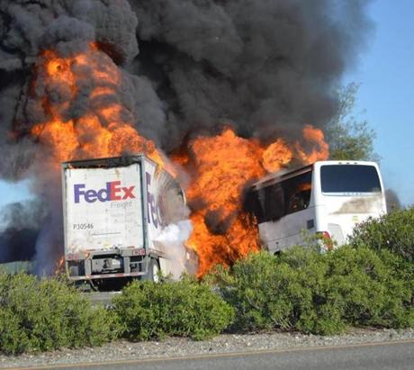 Massive flames engulfed a tractor-trailer and a tour bus just after they collided on Thursday.